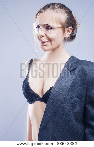 Humorous Shot Of Young Caucasian Blond In Lingerie Dressed In Grey Suite
