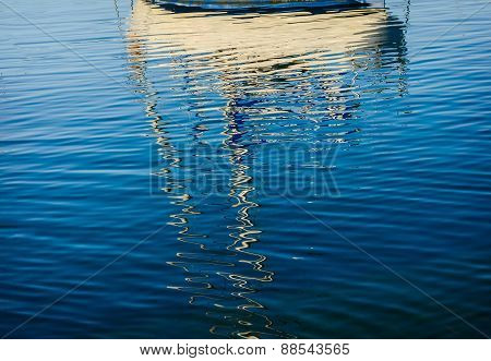Abstract reflections of boats in the harbor water