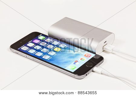 Charging a mobile phone with portable USB power bank