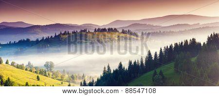 Fantastic morning mountain landscape. Colorful sky. Carpathian, Ukraine, Europe. Beauty world.