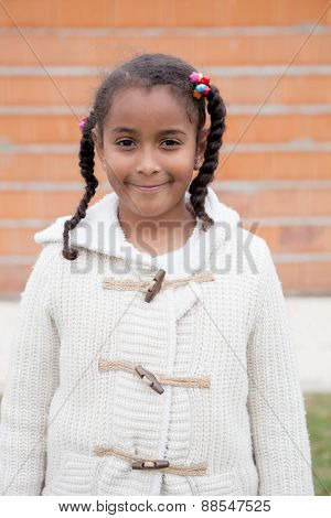 Beautiful african child with a brick wall of background