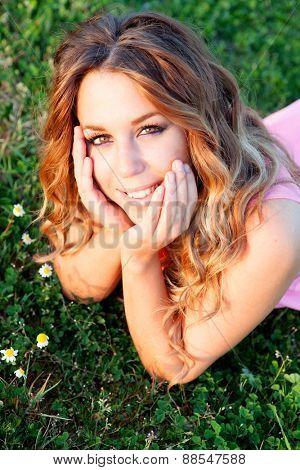 Pretty blonde woman in a beautiful field full of flowers