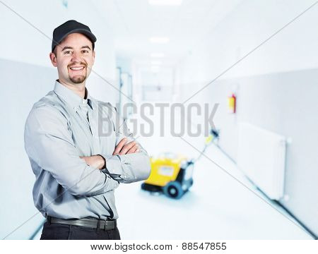 portrait of smiling attendant and indoor background