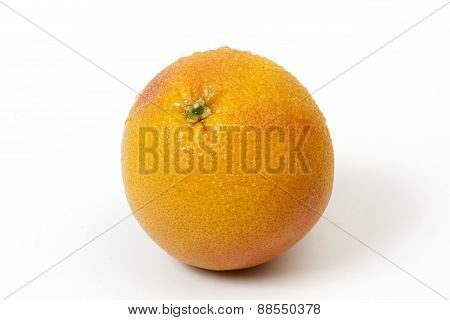 Grapefruit With Water Drops Over White Background