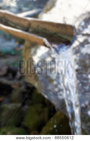 Blurry Defocused Water Flowing Through Bamboo For Background