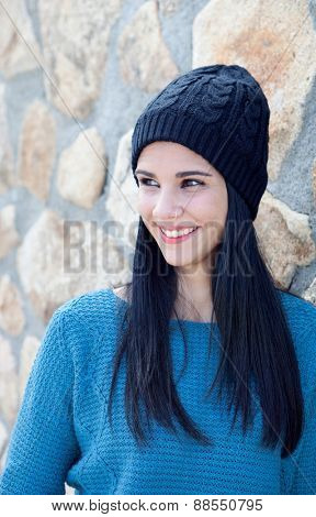 Pretty brunette girl with wool cap and piercing