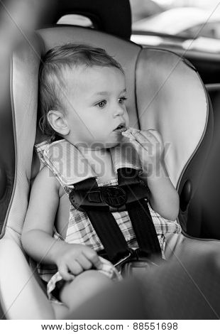 Happy Toddler Boy In The Car Eating