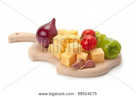 Cheese And Vegetables On Wooden Board