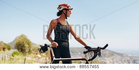 Determined Female Cyclist Looking Away