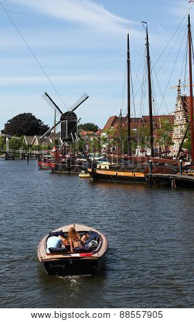 Canal Boat And Windmill in Leiden Netherlands