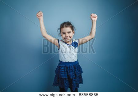 a girl of seven European appearance brunette raised her arms up