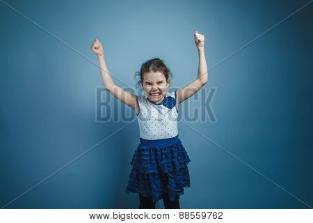 a girl of seven European appearance brunette raised her hands up