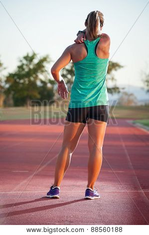 Female Runner On An Athletics Track