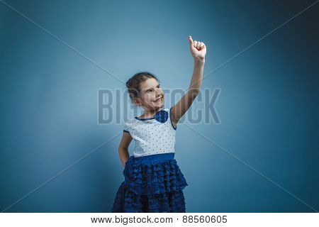 a girl of seven European appearance brunette smiling holding fin