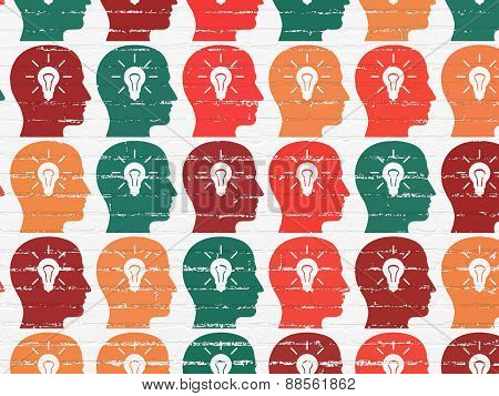 Marketing concept: Head With Light Bulb icons on wall background