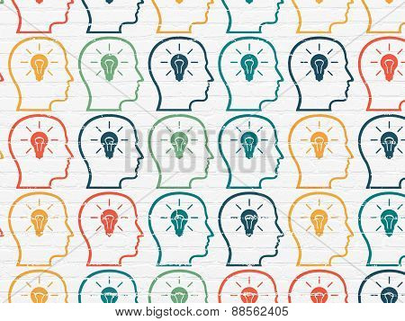 Marketing concept: Head With Lightbulb icons on wall background