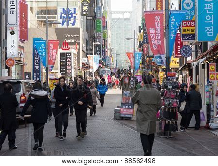 Urban Scene With Many Unidentified People Walk Around Walking Street In Myeong-dong Market In Seoul,