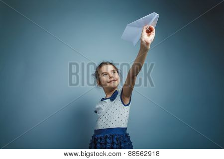 a girl of seven European appearance brunette holding a paper air
