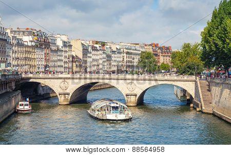 Touristic Boat By Batobus Goes Under The Pont Neuf