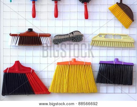Various Brooms And Brushes