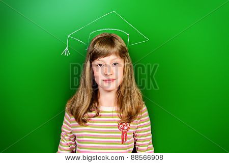 Smart schoolgirl stands at the blackboard in the classroom. Educational concept. New idea.