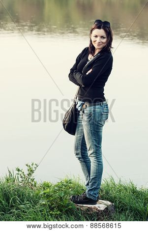 Young Brunette Posing On The Lakeshore