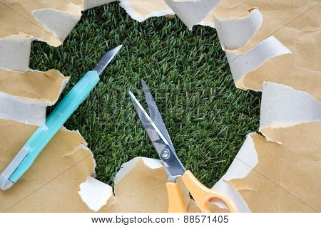 Scissors And Cutter On Torn Paper