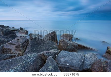 Beautiful Baltic Sea Landscape With Stone Breakwater. Tranquil Long Exposure Landscape