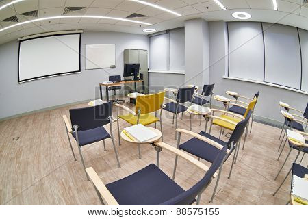 Empty Classroom With ?hairs And Notepads