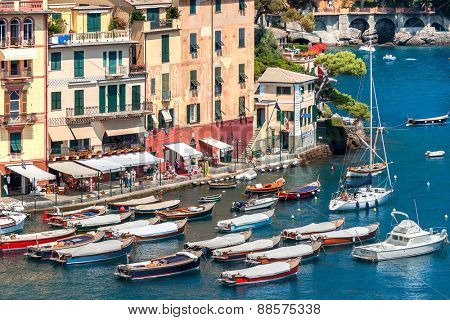 PORTOFINO, ITALY - AUGUST 05, 2011: Boats and colorful houses of Portofino - small village and popular tourist resort on Italian Riviera, famous for its picturesque harbor and celebrity visitors.