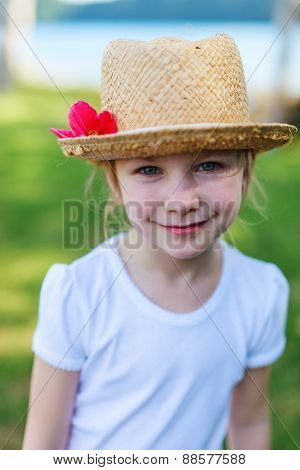 Casual portrait of little girl outdoors on summer day