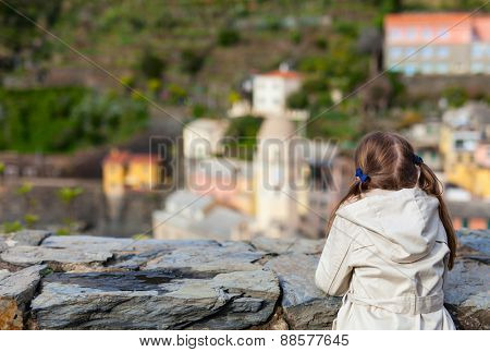 Little girl enjoying scenic view of colorful Vernazza village, Cinque Terre, Italy