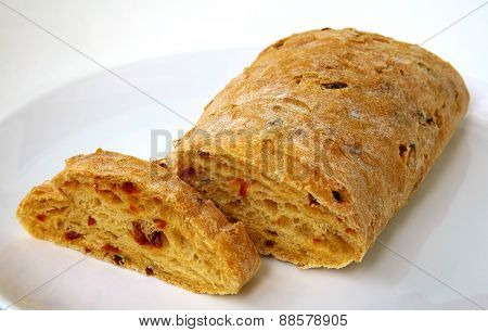 Italian Ciabatta With Paprika On White Plate