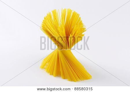 bundle of uncooked spaghetti on white background
