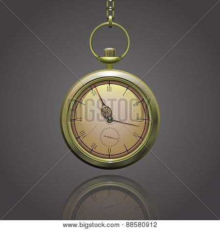 Gold vintage pocket clock on a chain with roman numerals on the grey background