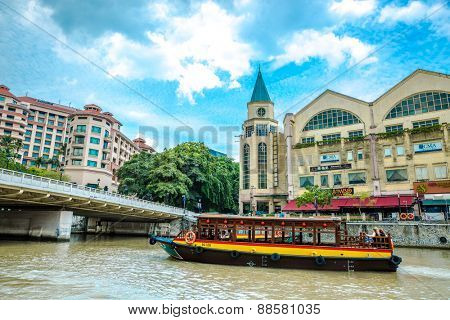 SINGAPORE - CIRCA NOVEMBER 2014: Touristic river boat on a river in Singapore.