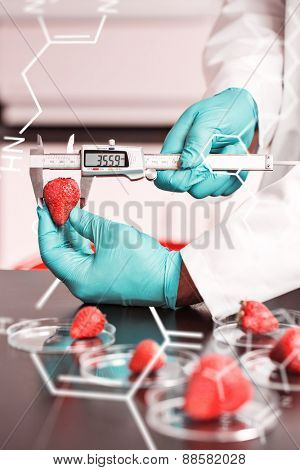Science and medical graphic against food scientist measuring a strawberry