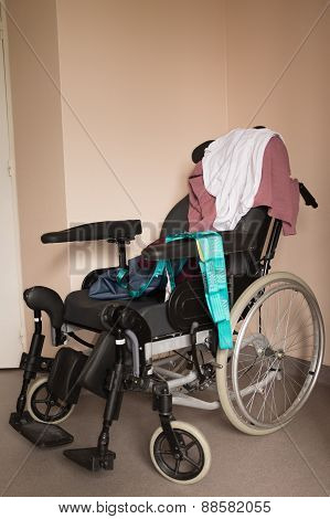 Wheel Chair With Nobody Just Clothes - Invalid Chair At Hospital