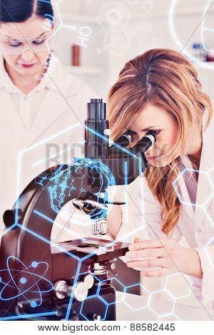 Science and medical graphic against young scientist looking through a microscope with her assistant