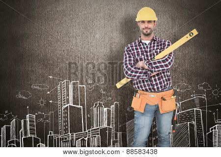Smiling handyman holding spirit level against hand drawn city plan