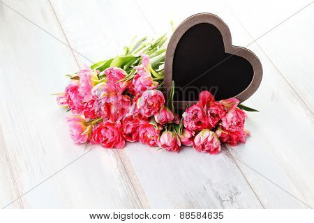 lots of pink tulips with heart - flowers and plants