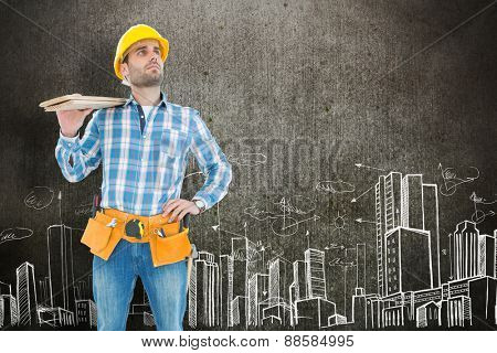 Thoughtful worker carrying wooden planks against hand drawn city plan
