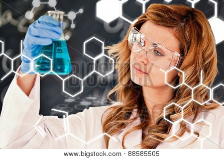 Science and medical graphic against beautiful female scientist looking at a flask