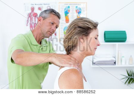 Doctor doing back adjustment in medical office