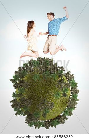 Cheerful young couple jumping against blue sky