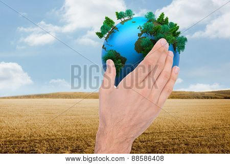 Businessman holding hand out in presentation against bright brown landscape