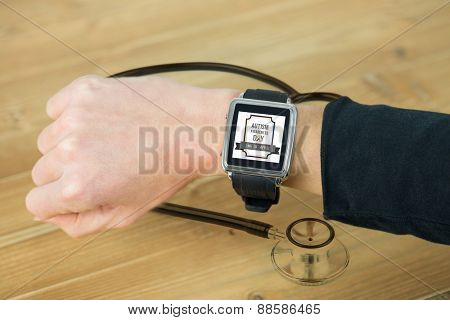 Businesswoman with smart watch on wrist against metal black stethoscope