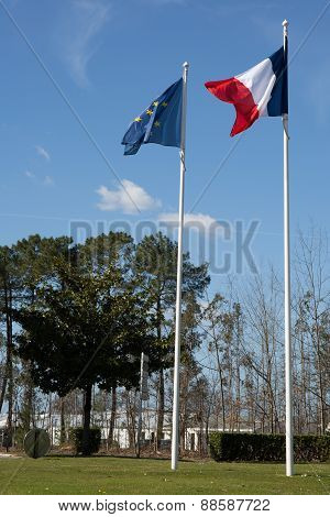 Flag Of France And European Union Flags Over A Blue Sky
