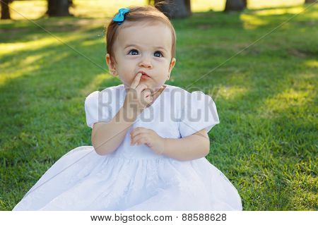 Cute Happy Little Baby Girl Scratching First Teeth In Park