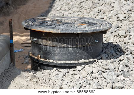 Sewer hole in road construction